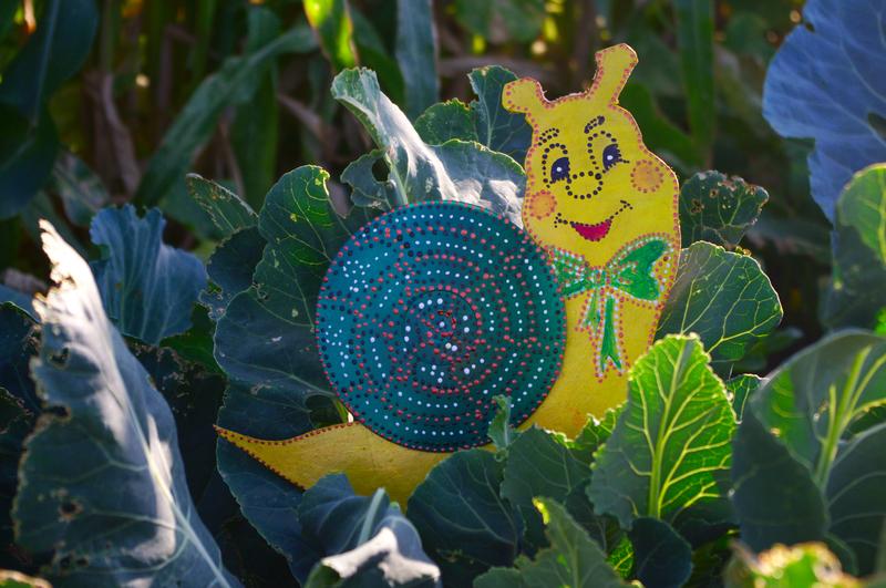 Сказочное оформление сада своими руками-улитка из диска фото 2