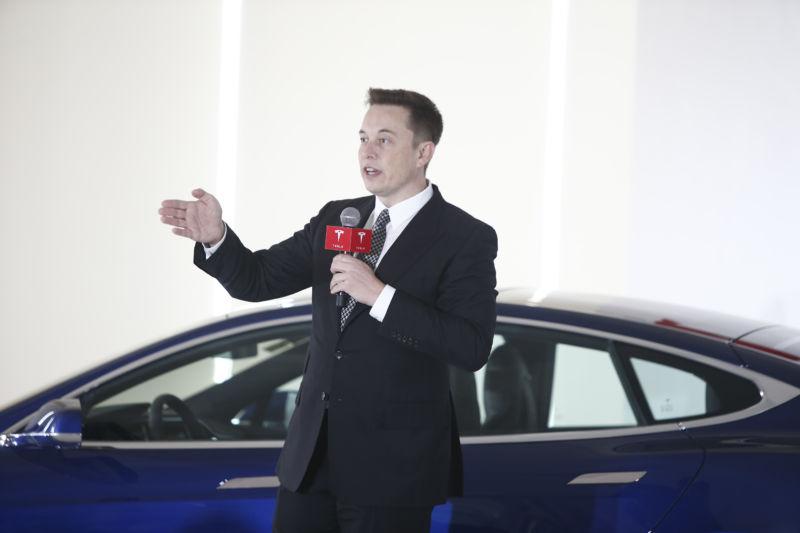 Elon Musk promises rain-sensing wipers, Tesla pickup truck